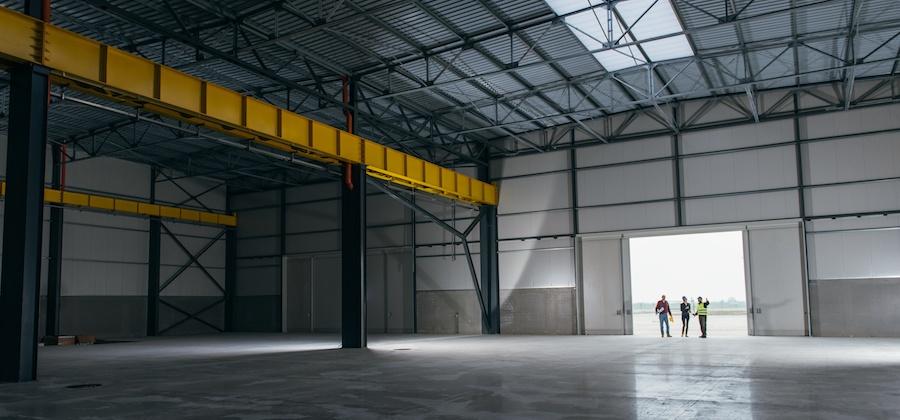 realtor-in-empty-warehouse